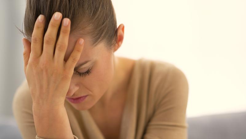 Stressad kvinna.